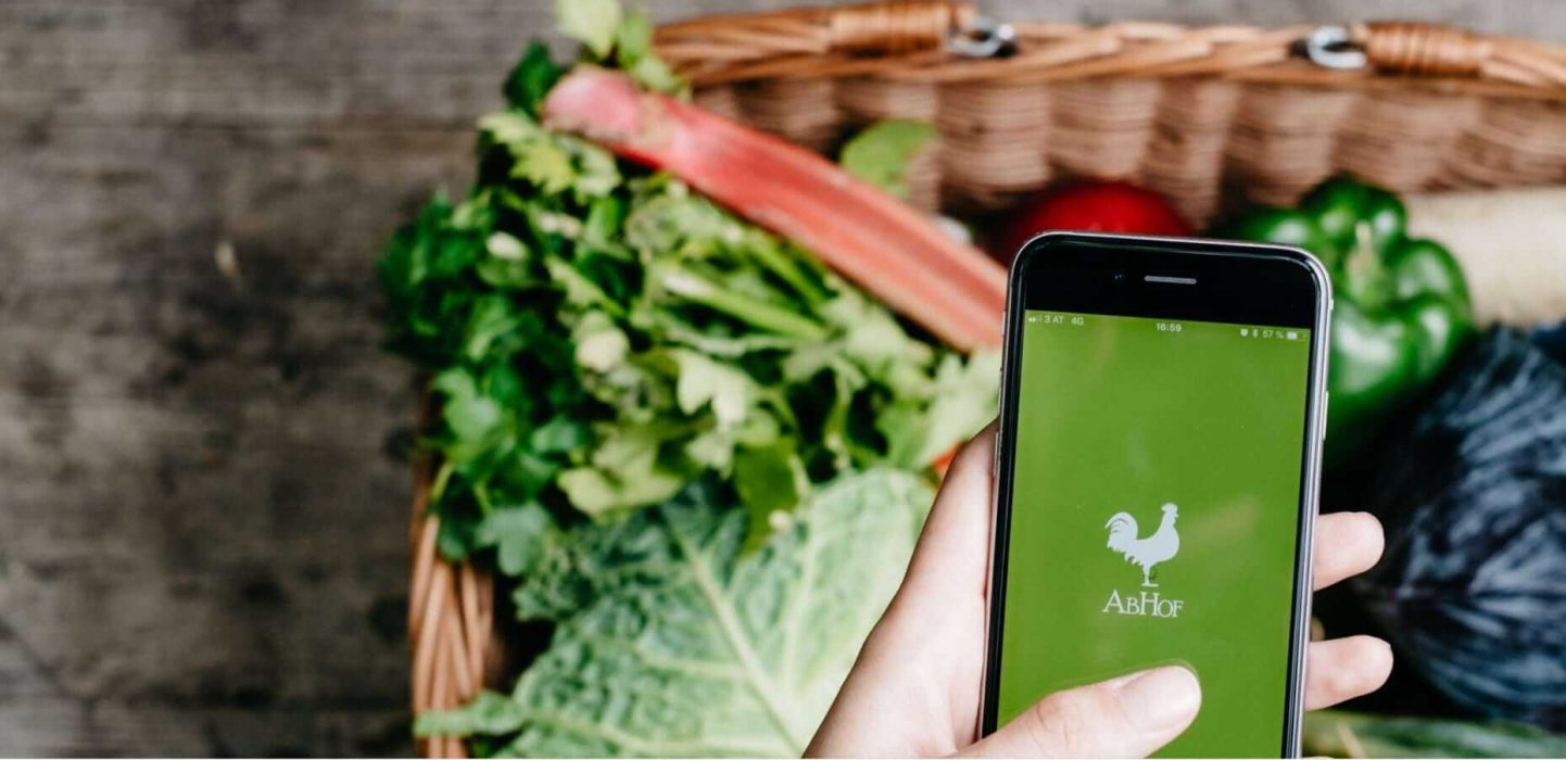 The Abhof app in focus with vegetables in the background